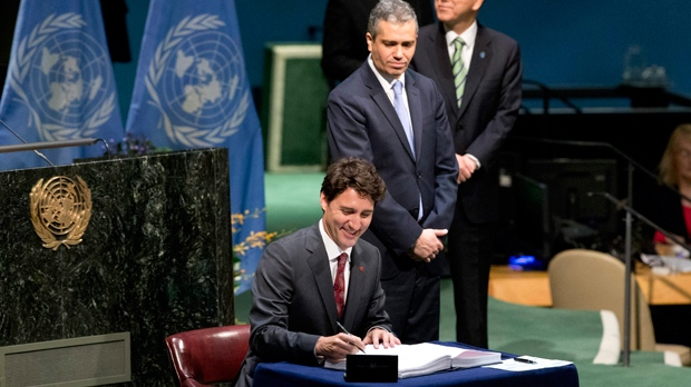 Trudeau signing Paris accord 22 Apr 16 Mary Altaffer-AP